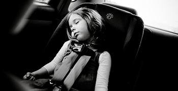 girl asleep in car seat-web size